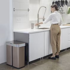 minimal kitchen highlighted by sensor can with voice and motion activation in rose gold! Minimal Kitchen, Trash Bins, Brushed Stainless Steel, Innovation Design, Home Remodeling, The Voice, Rose Gold, Canning, House