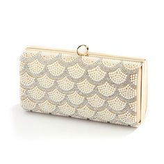 """Mariell's top-selling crystal and Ivory pearl wedding clutch shimmers with an elegant scalloped design. A sleek gold frame adds class to this must-have evening bag. 7"""" w x 3 1/2""""h. Detachable shoulder"""