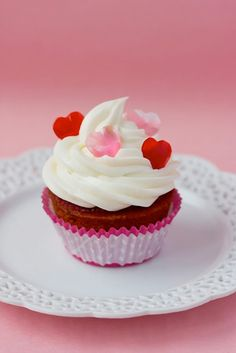 Red Velvet Cupcake With Cream Cheese Frosting And Pink And Red Fondant Heart Sprinkles! :D