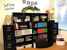 What a great idea to put shelving like this behind your small group table. That way all your materials are right there.: