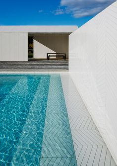 Zigzagging parquet covers every surface of the swimming pools, spa buildings and patio designed by Stockholm studio Claesson Koivisto Rune