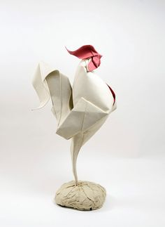 Vietnamese artist Hoàng Tiến Quyết produces curved paper forms using a difficult technique known as wet-folding.