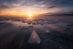 The Pointer by Ole Henrik Skjelstad  Tyrifjorden cannot exactly boast of monumental icebergs, but we have these eh ice cubes ;) The foreground is a focus stack and the sky is a blend of two exposures to control the strong light.  Ole Henrik Skjelstad: Photos          500px