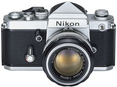 Nikon F2 with non metered prism. WONDERFUL. Smoother mirror movement than the original F. Introduced about 1972 to combat the Canon F1. Because of the 1959 lens mount, meter coupling was external. They have finally gotten around this with the digital models.