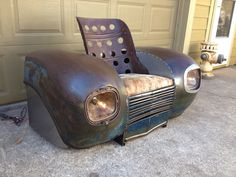 1939 Plymouth fenders and grill with a ww2 bomber seat now a one of a kind chair.