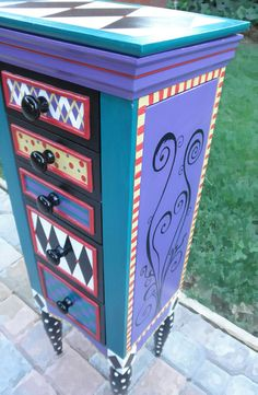 Jewelry Armoire, ALICE IN WONDERLAND painted with geometric patterns and my signature swirls. This armoire is a bright, colorful addition to any