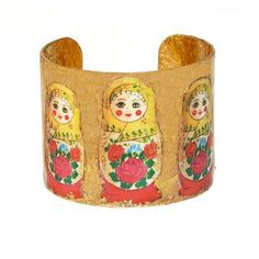 Russian Dolls Cuff. The first Russian nested doll set—known as the Matroyshka doll—was carved around 1890. This exquisite 22-karat gold leaf cuff looks like one of Vasily Zvyozdochkin's originals with its vintage detailing. $338.00