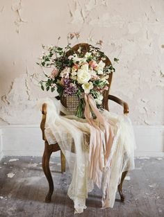 Beautiful bouquet in shades of pink, dusty rose, ivory and lavender. Bridal bouquet by Wild Green Yonder, lace veil from Gossamer Vintage, ribbon from Silk & Willow, image by Laura Gordon Photography.