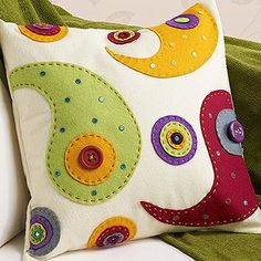 Appliqued paisley Pillow - Love the colors but have some concerns about the comfort of buttons.