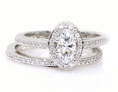 Hey, I found this really awesome Etsy listing at http://www.etsy.com/listing/154044154/marquise-moissanite-engagement-ring
