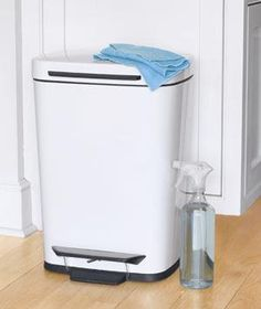 Tip: When cleaning the kitchen trash can, spray the can inside and out with a cleaner designed for pet messes. These products contain enzymes that kill bacteria and neutralize odors.