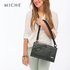 Get a little wild with untamed leopard spots like the ones on our Becky Classic Shell. Her dark pine needle green and high-gloss faux leather will feed your adventurous side as you hit the town.   #MicheBag http://mollymccollum.miche.com/ #Miche