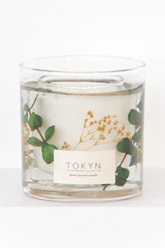Encased in real flowers and greenery. Totally not your average candle.