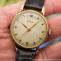 A 1945 Vintage Longines with unique, coin-edges sides. This wristwatch features a patinated, silver dial with applied, yellow gold Arabic numerals & arrow markers, along with a 23M, manual caliber movement. (Store Inventory # 11171, listed at $2500,... #longines #gold #round #dresswatch #vintagewatches #classicwatches #classic #vintage #watch #watches #cool #wristwatch #collectible #timepiece #stawc