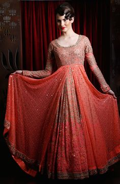 Indian Women Suits - Anarkali | WedMeGood Coral Red Suit with Gold and Silver Sequins work, Full Sleeves Floor Length Anarkali with Gold and Silver Embroidery and Mirror work. #wedmegood #anarkali #sequins #mirror