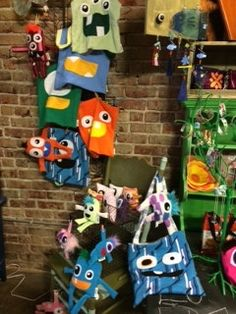 Monster Display.  Used bed spring on wall and chair, with baskets. Lu&Ed Monster's.