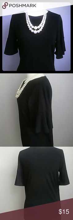 LOFT BLACK BELL SLEEVE MEDIUM TOP LOFT CLASSIC BLACK TOP. FEMININE BELL SLEEVES AND A LOOSE FIT MAKE THIS SHIRT SO FLOWING & ROMANTIC. SIZE MEDIUM. RAYON POLYESTER SPANDEX BLEND. GREAT SHIRT. GREAT CONDITION. LOFT Tops