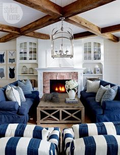 The Dream Beam! Using Faux-Beams for a Gold-Medal Style on a Fools-Gold Budget. Lovely fireplace, built ins and the blue.