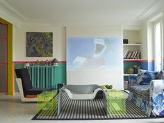 Chairish <3: this colorful, eclectic living room with splashy blue couch, clear green tables and colorblock walls