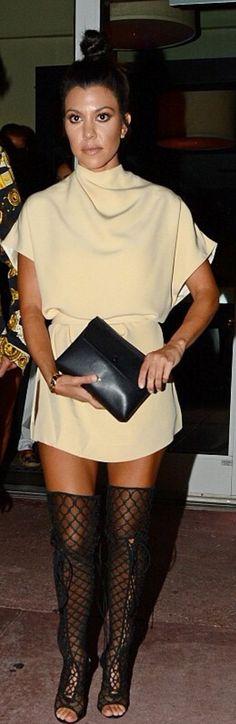 Who made  Kourtney Kardashian's gold jewelry, black thigh high boots, and black clutch handbag?