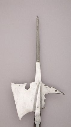 Halberd | German | The Met Date:early 16th century Culture:German Medium:Steel, wood (oak) Dimensions:L. 84 7/8 in. (215.5 cm); L. of head 17 3/8 in. (44.1 cm); W. 10 1/2 in. (26.6 cm); Wt. 5 lbs. 2 oz. (2320 g) Classification:Shafted Weapons Credit Line:The Collection of Giovanni P. Morosini, presented by his daughter Giulia, 1932 Accession Number:32.75.194