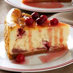 """Winning Cranberry Cheesecake Recipe -The holidays wouldn't be complete without cranberries and eggnog. I use them both in this flavorful cheesecake that's the perfect finale for a special dinner. Set it out at the start of the meal, not just to solicit """"oohs"""" and """"aahs,"""" but to remind folks to save room for dessert! —Nancy Zimmerman, Cape May Court House, New Jersey"""