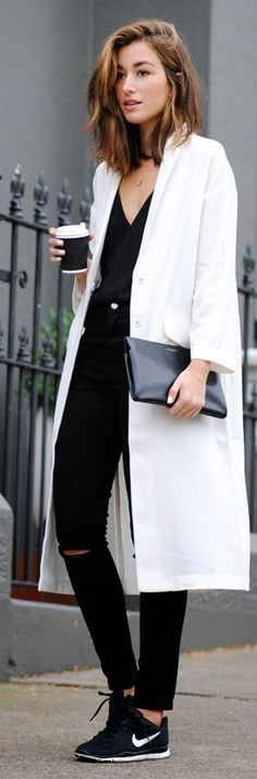 White lightweight trench coat + black Nike trainers + black skinny jeans and top