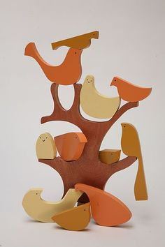 Bird on a Tree puzzle is elegant and invites creative solutions. Unfortunately the company no longer makes it. But maybe it can inspire someone else! Beautiful.