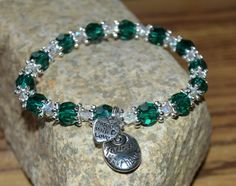 Follow Your Heart Hope Angel Bracelet. A beautiful reminder to follow your heart as you journey through life! So many times we need gentle reminders to listen to our hearts, not the dreams others have for us. Just look at this pretty bracelet to remind you to always follow your heart! Beautiful emerald green Swarovski crystal with small, clear crystal spacers. Also a small Made with Love charm attached.