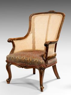 A high backed walnut framed library arm chair, the underside is stamped by Johnson & Jeanes 67 New Bond Street. London 15829. Offered by Lennox Cato at The Edenbridge Galleries, Kent. www.edenbridgegalleries.com