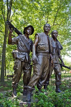 Vietnam Memorial Statue stands by the Vietnam Memorial. Designed by Fredrick Hart who said he tried to capture the sacrifice given on their faces.