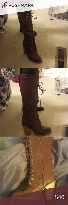 Burgundy boot that lace up the front. These Boots Are brand-new they've never been worn they're beautiful color of deep burgundy brown that lace up the front two and a half inch heel Shoes Lace Up Boots