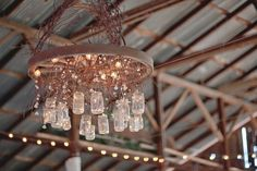 I promised my best friend that this would be her wedding gift from me. Mason Jar Chandelier