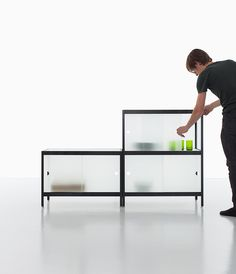 julien renault and kewlox presents 'mist', a modular system with textured glass doors, drawing focus to the frame while blurring the objects inside.