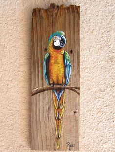 Hand painted Parrot Plaque in Turquoise with Orange can be displayed almost anywhere indoors or out (under a covered area). Parrot is hand painted with acrylic paint in my Rose Artworks studio on a reclaimed fence board and then sealed with a clear UV resistant sealer for beauty and durability. Parrot can be done in any color of your choice. Just convo me with your ideas. CUSTOM ORDER ONLY (please allow at least 2 weeks for delivery) Item measures approximately 15 inches vertical by 5…