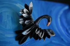 Do you like swans? Do you like playful but beautiful pieces? I certainly do. This unusual and elegant hair-sculpture makes a great fascinator. While not perched in your Up-Do, it also makes a lovely addition to a flower arrangement, or can be set on a piece of pottery for display. Do you like a white swan, or a black? They remind me of Odette and Odile. **This technique** is called tsumami kanzashi . It takes me hours to complete one swan, but the effect is worth it! Please choose the…