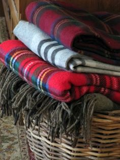 basket of cozy plaid throws... would use these throw at christmas time or use to take on a picnicxxxxxxxxx