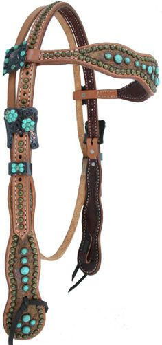 Cowboy-headstalls Cowboy Headstall with butterscotch croc hide, turquoise stones, square bronze berry conchos with turquoise stones between the berries, and bronze floral crystal buckle sets.  $205 as shown