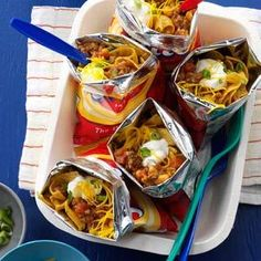 Walking Tacos Recipe -These Walking Tacos are great for an on-the-go dinner, campfire meal or easy game night supper. The ingredients go right into the chip bags! —Beverly Matthews, Pasco, Washington