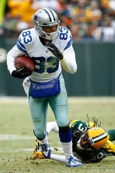 Terrance Williams #83 of the Dallas Cowboys runs the football in for a touchdown, past Tramon Williams #38 of the Green Bay Packers,