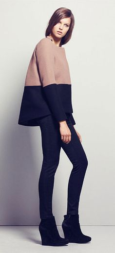 The color block and the wedged boots help to take away from the shapelessness of the top. Nicely done.