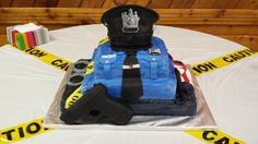 Police Academy graduation - Chocolate cake w/vanilla butter cream, tinted butter cream icing. Fondant accents.