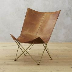 Shop Brown Leather Butterfly Chair.   Modern take on legendary design shelters with cocoon-like comfort.  Brass frame's accordion shape supports leather sling with worn vintage look.  Over time, leather gains richness with zero upkeep.