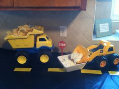 Chips and dip for dump truck birthday party. Took black table clothes and yellow tape to make counters look like a road!