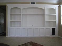 Built in wall unit.  Love this!  In basement, only the 2 side bookshelves would be windows!