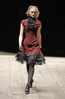McQueen. I like the way the use of the plaid kinda modernizes a very vintage kinda cutting.