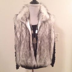 """Black & White Sable Faux Fur Vest NWOT Gorgeous Boutique sable faux fur black & white vest. NWOT. Very chic. No tags. Will fit small or medium. 3-Hook and loop closure. 22"""" shoulder to hem. 21"""" pit to pit lying flat across back. ❌ NO TRADES ❌ NO PP❌ NO LOWBALLING ❌ Boutique Jackets & Coats Vests"""