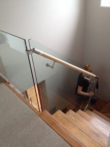 Through glass brackets with a timber handrail