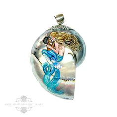 """""""Mother & Baby Mermaid"""" Custom OOAK Hand Painted Mermaid Art Shell Pendant Jewelry (2016)  A gorgeous custom mermaid art pendant hand painted using non-toxic acrylic paints and sealed with a beautiful high gloss water-resistant lacquer on a polished nautilus shell. A beautiful mother mermaid holds her lovely mer-baby gazing tenderly at one another.  This special pendant celebrates the love between a mother and child, a beautiful keepsake and stunning statement piece."""