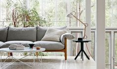 Dexter side table in black. Efficiently designed byJardanfrom one piece of timber. Also love that Wilfred sofa and Fred coffee table, both by Jardan Lab.